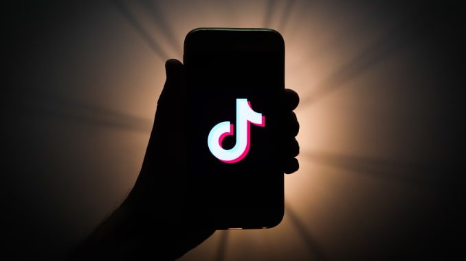 TikTok logo is seen displayed on a phone screen in this illustration photo taken in Krakow, Poland on November 13, 2019. (Photo by Jakub Porzycki/NurPhoto via Getty Images)